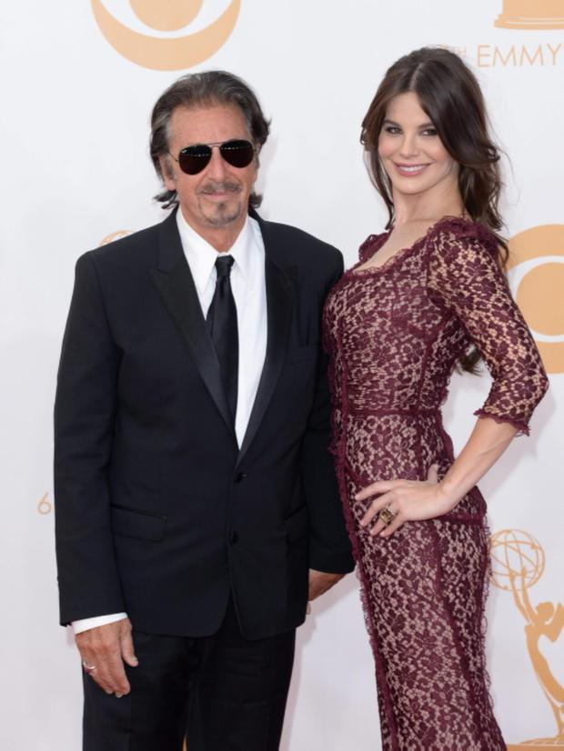 LOS ANGELES, CA - SEPTEMBER 22: Actor Al Pacino (L) and Lucila Sola arrive at the 65th Annual Primetime Emmy Awards held at Nokia Theatre L.A. Live on September 22, 2013 in Los Angeles, California. (Photo by Jason Merritt/Getty Images)