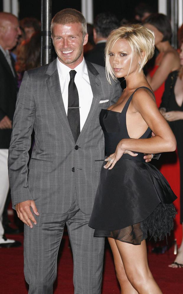 Football star David Beckham and singer Victoria Beckham arrive at the Beckham Welcome To LA Party at the Museum of Contemporary Art on July 22, 2007 in Los Angeles, California. (Photo by Jean Baptiste Lacroix/WireImage)