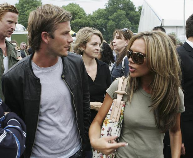 David and Victoria Beckham are seen backstage at Live 8 London in Hyde Park on July 2, 2005 in London, England. The free concert is one of ten simultaneous international gigs including Philadelphia, Berlin, Rome, Paris, Barrie, Tokyo, Cornwall, Moscow and Johannesburg. The concerts precede the G8 summit (July 6-8) to raising awareness for MAKEpovertyHISTORY. (Photo by Daniel Berehulak/Live 8 via Getty Images)
