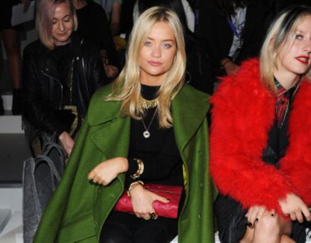 Presenter Laura Whitmore attends the Zoe Jordan show - her oversized green peacoat thrown over her shoulders is a style winner.