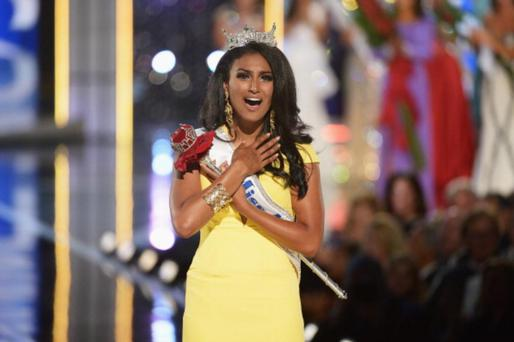 ATLANTIC CITY, NJ - SEPTEMBER 15: Miss America 2014 contestant Miss New York Nina Davuluri wins the 2014 Miss America Competition at Boardwalk Hall Arena on September 15, 2013 in Atlantic City, New Jersey. (Photo by Michael Loccisano/Getty Images)