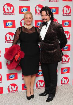 Laurence Llewelyn-Bowen (right) and Jackie Bowen (left) arriving for the 2013 TV Choice awards at the Dorchester Hotel, London. PRESS ASSOCIATION Photo. Picture date: Monday September 9, 2013. See PA story SHOWBIZ TV Choice. Photo credit should read: Ian West/PA Wire