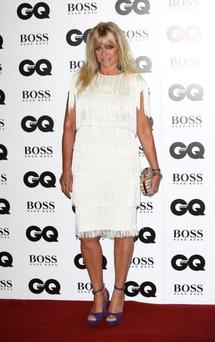 Jo Wood failed to impress in this ill-fitting cream, fringed dress, although the box clutch gets our thumbs up.