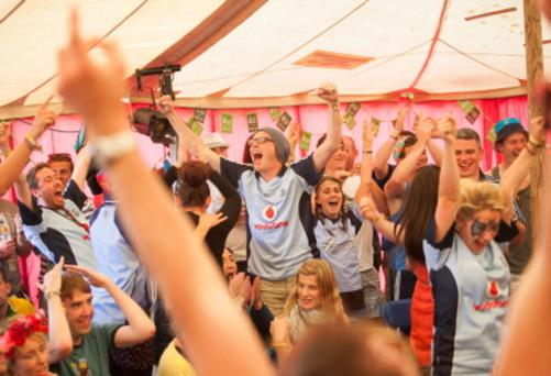 Dublin fans celebrate in the An Puball Gaeilge tent at Electric Picnic. Dublin and Kerry fans jammed the small An Puball Gaeilge tent at Electric Picnic which through an intermittent internet connection was the only place fans could see the match. Picture: Tony Kinlan.
