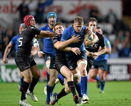 12 October 2013; Jamie Heaslip, Leinster, is tackled by Dan Biggar, Ospreys. Heineken Cup 2013/14, Pool 1, Round 1, Ospreys v Leinster, Liberty Stadium, Swansea, Wales. Picture credit: Stephen McCarthy / SPORTSFILE