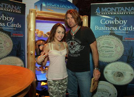 With dad,Billy Ray Cyrus,at the Academy of Country Music Awards held at the MGM Grand Garden Arena on May 23, 2006