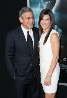 "NEW YORK, NY - OCTOBER 01: George Clooney and Sandra Bullock attends the ""Gravity"" premiere at AMC Lincoln Square Theater on October 1, 2013 in New York City. (Photo by Dave Kotinsky/Getty Images)"