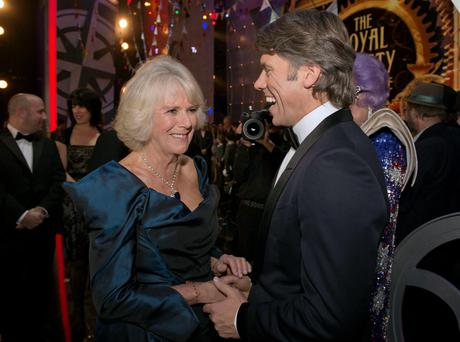 Duchess of Cornwall speaks with John Bishop during the Royal Variety Performance, at the London Palladium, in central London.