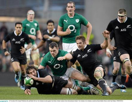 Samuel Whitelock, left, and Richie McCaw, New Zealand, in action against Cian Healy, Ireland.