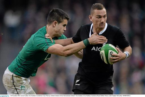 Aaron Cruden, New Zealand, is tackled by Conor Murray