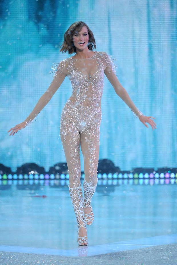 Karlie Kloss walks the runway wearing Bodysuit using Swarovski Crystals at the 2013 Victorias Secret Fashion Show
