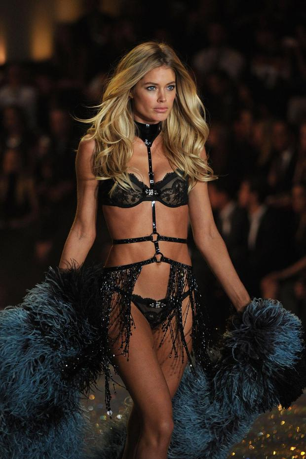 Doutzen Kroes walks the runway wearing Harness with Swarovski Crystals at the 2013 Victorias Secret Fashion Show