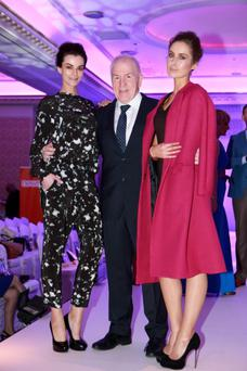 Minister Jimmy Deenihan,with Karen Fitzpatrick, and Roz Purcell, at the Oireachtas Charity Fashion show at the Shelbourne Hotel, Dublin. Picture:Arthur Carron/Collins