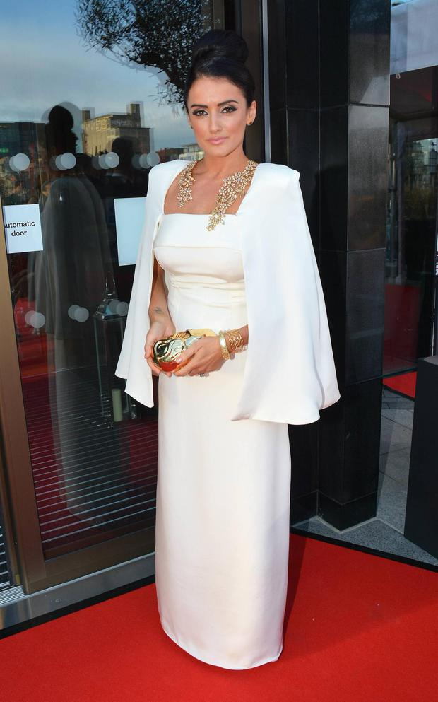 Virginia Macari does her own version of Gwyneth Paltross Tom Ford cape at the Oscars for this years Style Awards.