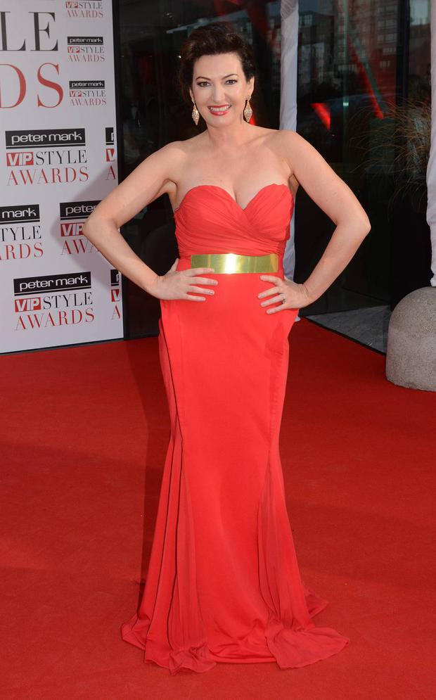 RTEs Maura Derrane dons a sensational red gown at this years VIP Style Awards. Sweetheart neckline. Gold chunky belt and immaculate hair and makeup make for a flawless look.