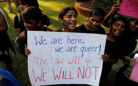 Gay rights activists shout slogans during a protest against the verdict by the Supreme Court in Mumbai December 15, 2013. India's Supreme Court on Wednesday reinstated a ban on gay sex in the world's largest democracy, following a four-year period of decriminalisation that had helped bring homosexuality into the open in the socially conservative country. In 2009 the Delhi High Court ruled unconstitutional a section of the penal code dating back to 1860 that prohibits