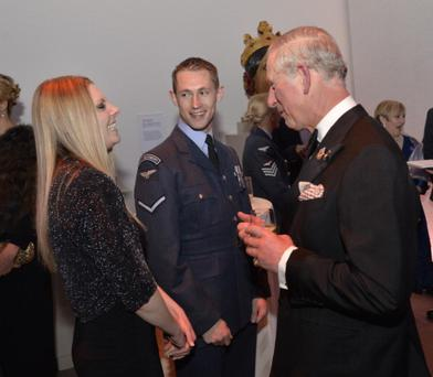 Prince Charles, Prince of Wales talks with Lance Corporal Alex Price and partner Vicki Jones during The Sun Military Awards