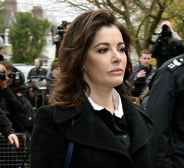 TV cook Nigella Lawson arriving at Isleworth Crown Court in west London to give evidence in the case two of her former personal assistants, Elisabetta and Francesca Grillo, who are accused of committed fraud by abusing their positions as PAs by using a company credit card for personal gain. Photo credit: Andrew Matthews/PA Wire