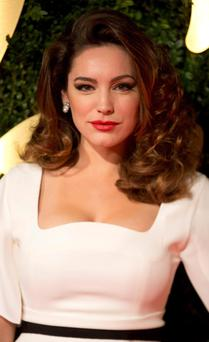 Model Kelly Brook attends the British Fashion Awards. REUTERS/Neil Hall