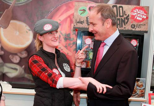 Sarah O'Connor from Cool Beans shares a joke with Micheál Martin in SuperValu's Good Food Karma tent
