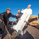 Farmer Tom Coffey from Waterford meets with Fr Piaras Jackson with a cut out of Pope Francis at the 2015 National ploughing championships in County Laois