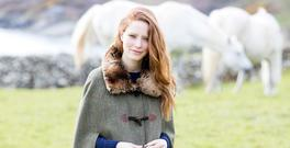 Tweed cape in Moss, €549, Gore-Tex boots in Mahogany, €395, Dubarry