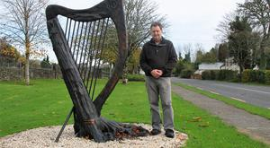 Harping back: 'Farming and art have gone hand in hand in this country for centuries,' says Brendan Collum, photographed with a piece of his bog oak in Keadue, Co Roscommon