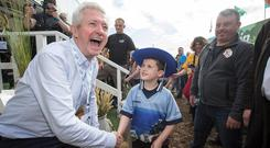 Stephen Newton from Tullamore meets with Louis Walsh at the opening day of the National Ploughing Championships in Screggan, Tullamore, Co Offaly. Photo :Mark Condren