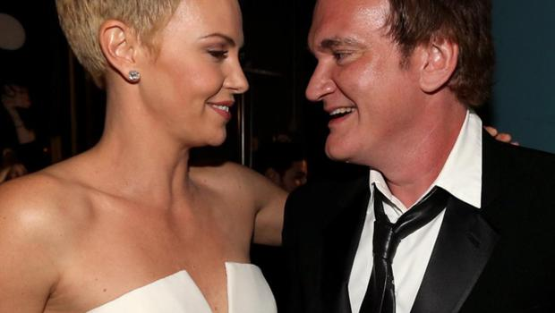 Quentin Tarantino and Charlize Theron backstage at the Oscars.