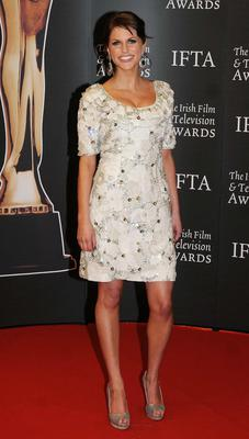 Amy is always on-trend and while you couldn't say that she has a fashion formula per se, she is clearly aware that short hemlines are a very good look for her, as she has killer legs. Here she is in an ivory Joanne Hynes dress at the IFTAs in 2009.