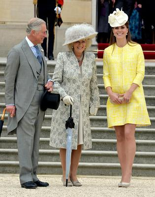 May 2013: The mum-to-be looks beautiful in Emilia Wickstead alongside Prince Charles and Camilla.