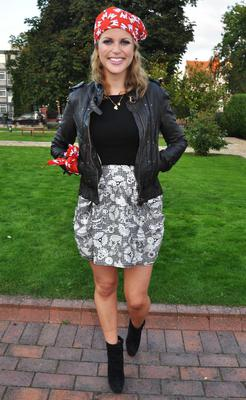 Here, at the launch of 'Buy A Bandana Campaign' in aid of Barretstown children's charity in 2009, Amy Huberman gives her floral skirt some edge with a leather biker jacket and black ankleboots.