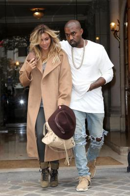 Kim Kardashian and Kanye West are seen on the Avenue Montaigne in Paris