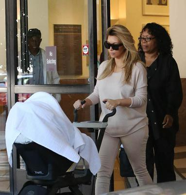 Kim Kardashian went for an understated look during a visit to the doctors office with baby Nori