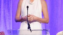 Honoree Charlize Theron accepts an award onstage during Variety's 5th Annual Power of Women event presented by Lifetime at the Beverly Wilshire Four Seasons Hotel on October 4, 2013 in Beverly Hills, California.