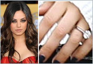 Mila Kunis was sporting a huge engagement and sources have confirmed shes engaged to Ashton Kutcher after two years together