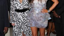 November 2012: Kim and big sister Kourtney pose in Miami. The expectant mum is in the very early stages of her pregnancy and opts for a pretty white and lilac peplum dress.