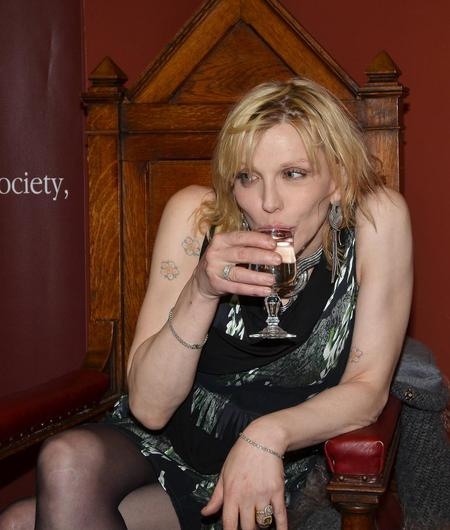 Grunge queen Courtney Love was rather animated during her presentation on an Honorary Patronage from Trinity College's Philosophical Society which she attended with friend Gavin Friday, in October 2010.