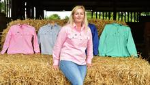 Looking the part: Claire Power with a selection of her Ballybar farm workwear shirts. Photo: Roger Jones