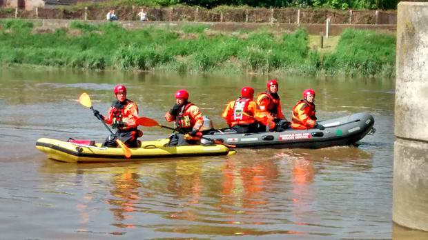 Firefighters used a raft and a boat to reach the stricken sheep at Stowbridge near King's Lynn, Norfolk. (RSPCA/ PA)