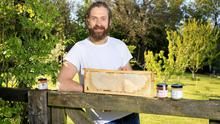 In demand: Beekeeper and farmer Olly Murphy pictured with some of his honey at his farm in Glenasmole Co Dublin.  Photo: Frank McGrath