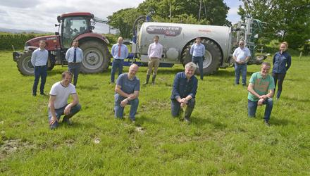 The four founding members of Ireland's first farmers' machinery co-op, Colm Kelleher, Patrick McSweeney, Brendan Hinchion and John Wood with their first purchase. Teagasc's Tom Curran (rear centre) organised the event. Also pictured are banking, insurance and machinery reps. Photo: Denis Boyle