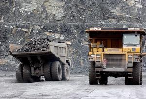 Lorries remov rocks from the pit floor at the CRH Plc. quarry in west Dublin, Ireland, Thursday, November 11, 2004.