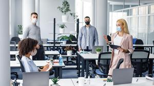 Where face-to-face meetings take place, participants must maintain physical distancing. Photo: Stock image