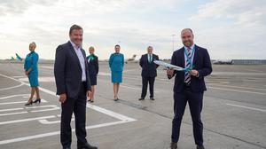 Conor McCarthy, CEO of Emerald Airlines and Reid Moody, chief strategy & planning officer, Aer Lingus with cabin crew from Emerald Airlines and Aer Lingus