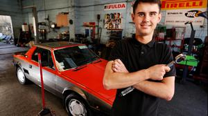Mechanic Mark Daly from Drimnagh working on a Fiat X19 at Lynch Motors in Rathgar. Photo: Steve Humphreys