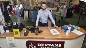 Rónán Dervan runs his family's shop, Dervan Fashions, which has been in business for 85 years in Loughrea with his father Ger and mother Mary. Photo: Ray Ryan