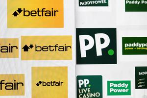 Betfair Group Plc logos, left, and Paddy Power Plc logos, right, sit on a computer screen in this arranged photograph in London, U.K., on Wednesday, Aug. 26, 2015. Paddy Power Plc and Betfair Group Plc plan to merge in a deal that creates the world's biggest publicly-listed online gaming company, the latest in a wave of combinations across the industry. Photographer: Matthew Lloyd/Bloomberg