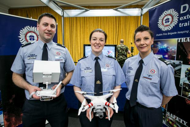 Dublin Fire Brigade's Ciaran Lalor with Teresa Hudson and Caroling Gunning pictured at the Drone Expo Show in the RDS.