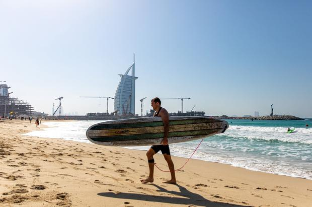 A tourist on Jumeirah beach in Dubai, United Arab Emirates. Picture by Christopher Pike/Bloomberg